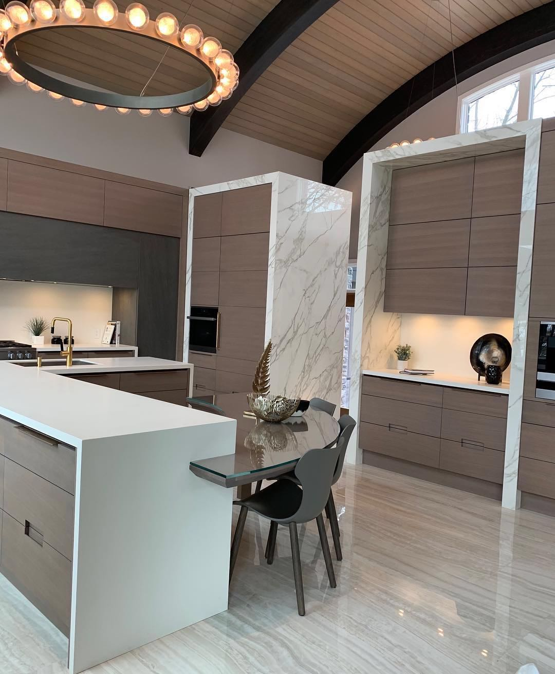 Island & Countertops - Neolith Arctic White | Upper Stove Wall - Neolith Basalt Black | Cabinet Surround - Neolith Calacatta