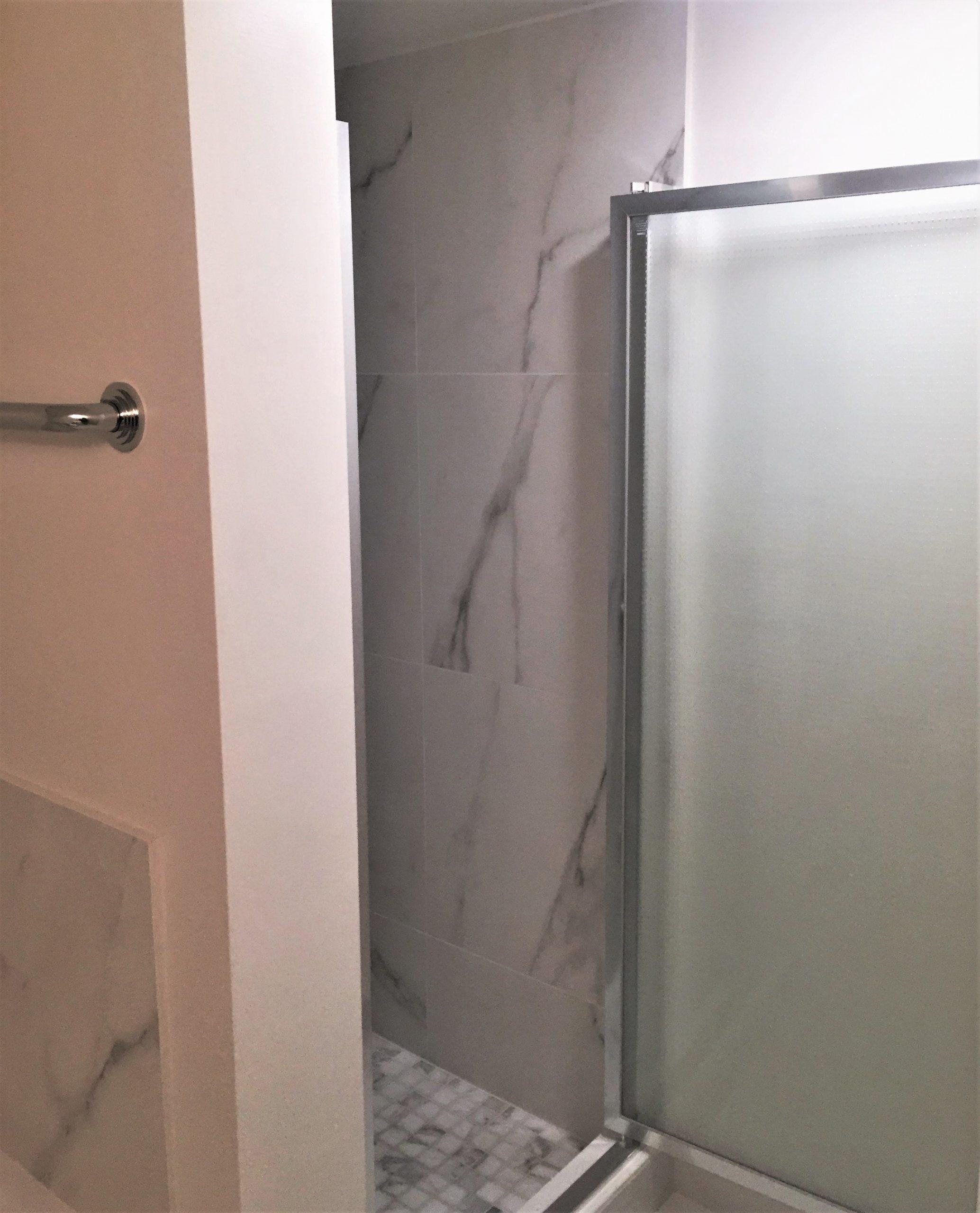 Walls: Motif Extra Calacatta Silver | Floors: Motif Extra Calacatta Silver