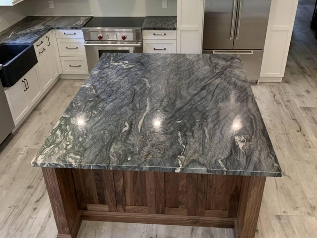 Countertops: Explosion Quartzite | Floor: Dakota Grigio Porcelain